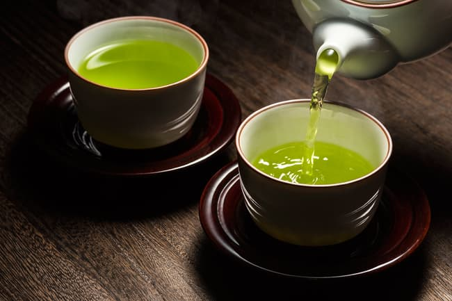photo of pouring green tea