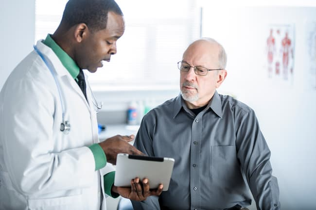 photo of doctor patient consultation