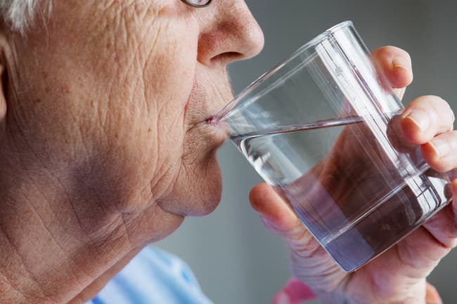 photo of person drinking water