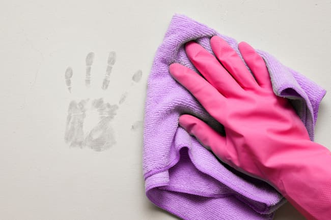 photo of cleaning fingerprints on painted wall