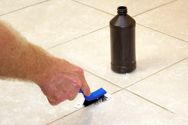 photo of cleaning grout on tile floor
