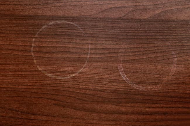 photo of water rings on wooden surface
