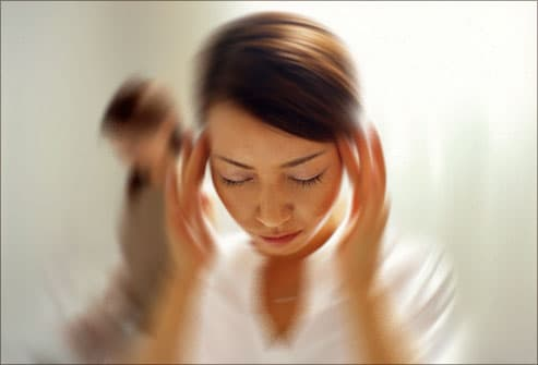 Woman experiencing extreme dizziness