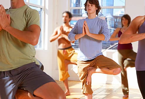 teen boy in yoga class
