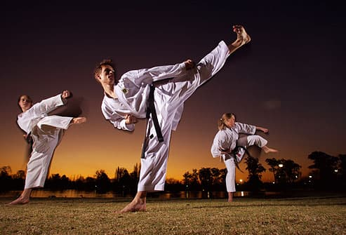 teens practicing karate
