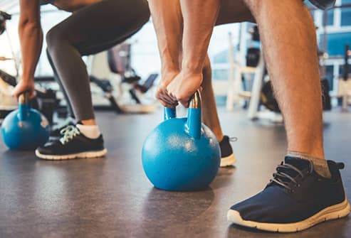 people working out with kettlebells