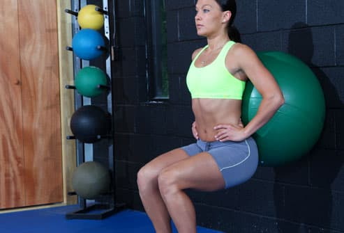 Woman Doing Ball Squat Exercise