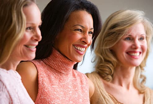 group of smiling mature women