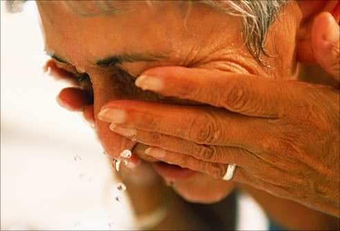 mature woman washing her face