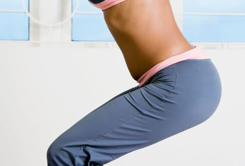 Midsection of woman doing squats