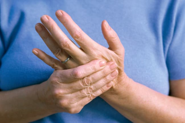 photo of woman rubbing hands