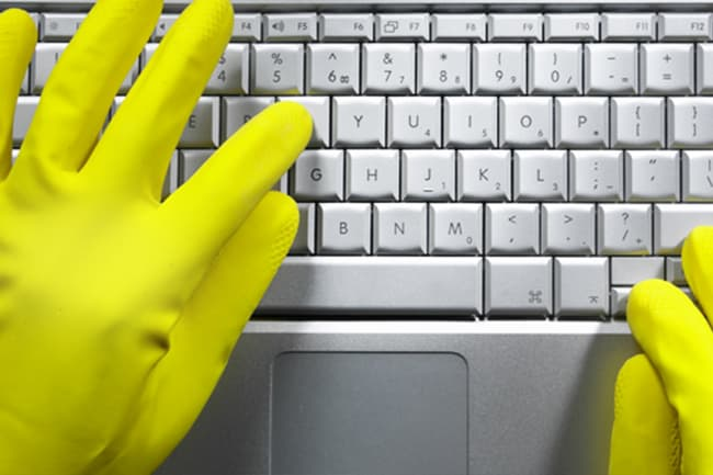 photo of gloved hands on keyboard