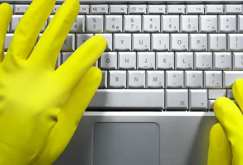 Hands in Dish Gloves Typing