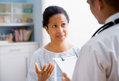 Female Patient Talking to Doctor