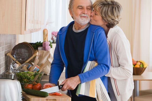 photo of couple in kitchen