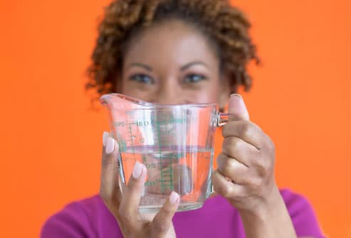 Lady Holding Measuring Cup