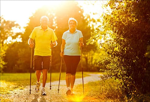 mature couple nordic walking