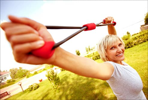 woman exercising with flex cable