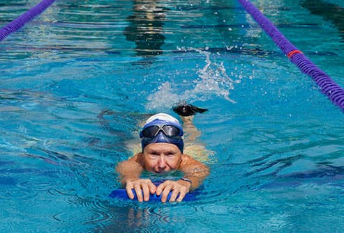 senior woman swimming laps