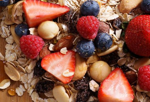 strawberries blueberries and granola