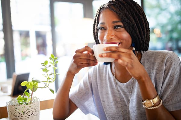 photo of woman drinking coffee
