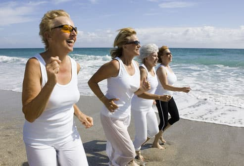 Older Women Running On Beach