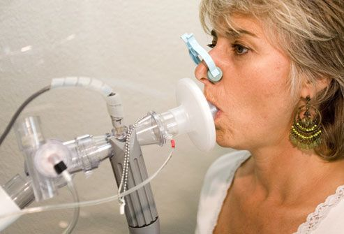 Woman taking a pulmonary function test