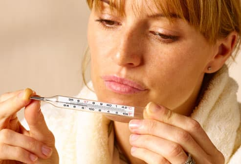 Woman reading thermometer