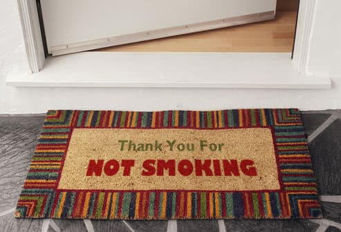 """Thank you for not smoking"" on door mat"