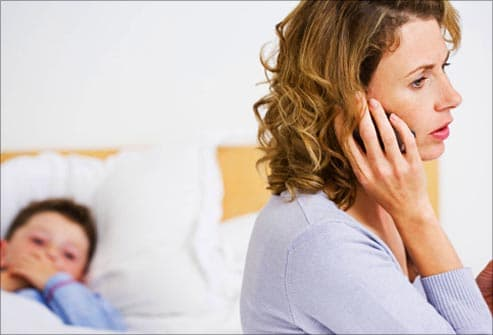worried mom calling doctor