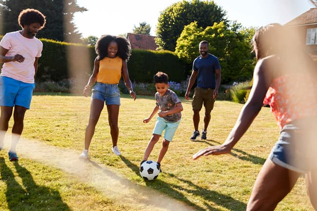 photo of family playing soccer