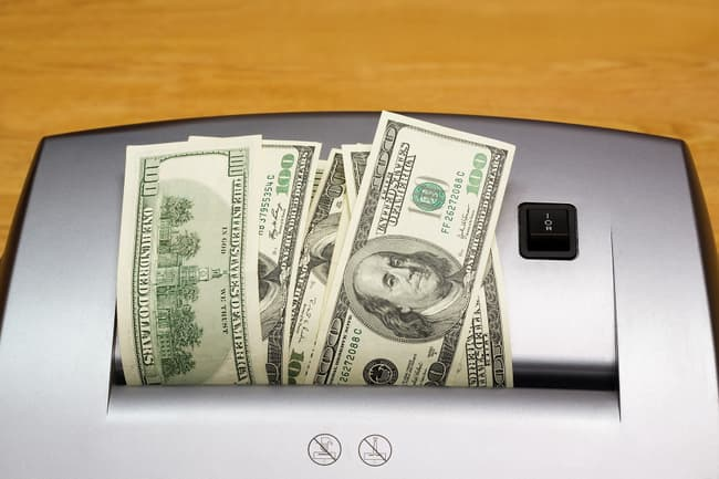 photo of money in shredder