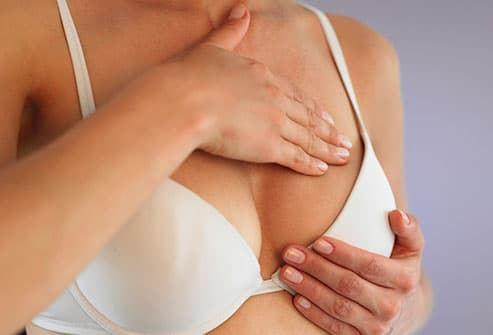 woman doing breast check