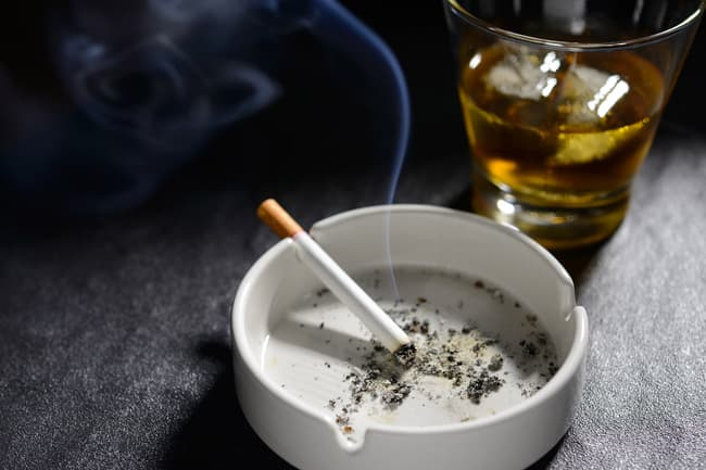 photo of mixed drink and cigarette
