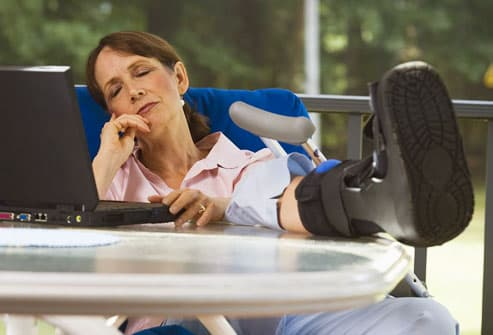 Woman resting leg after injury