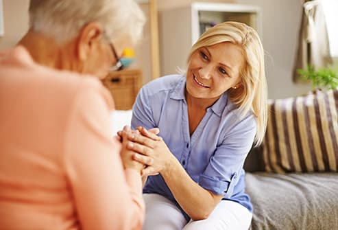 caregiver talking with senior