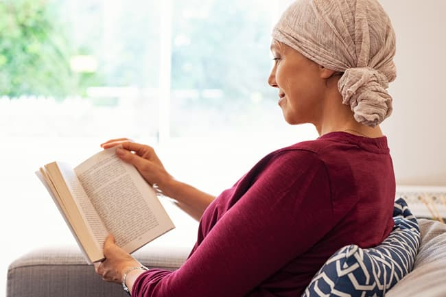 photo of woman in headscarf reading