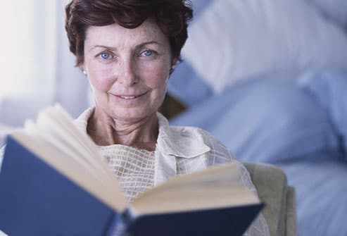 Older Woman Reading Book