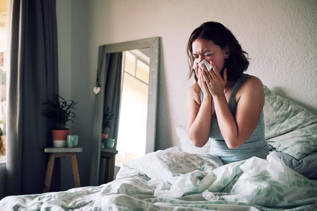 photo of woman blowing nose