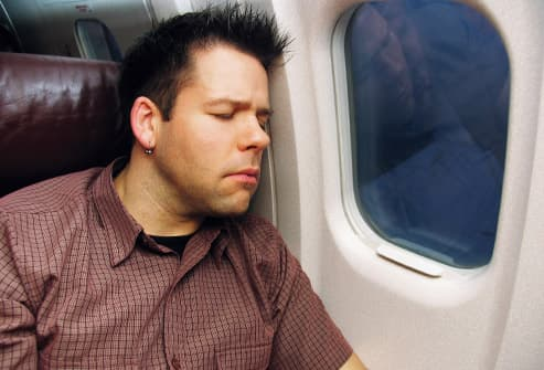 man sleeping on airplane