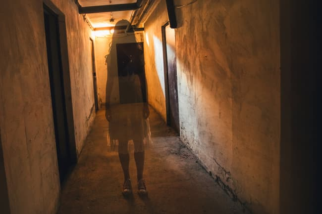 photo of ghost-like image of woman in hallway