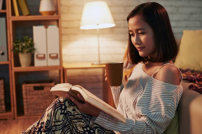 photo of woman relaxing with book