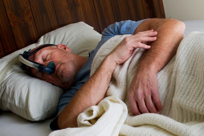 photo of man sleeping with cpap mask