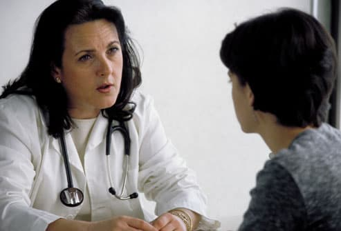 Doctor discussing celiac disease with woman