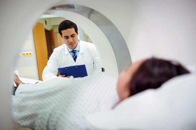 photo of person being scanned using mri