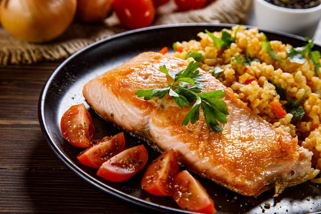 photo of grilled salmon and vegetables