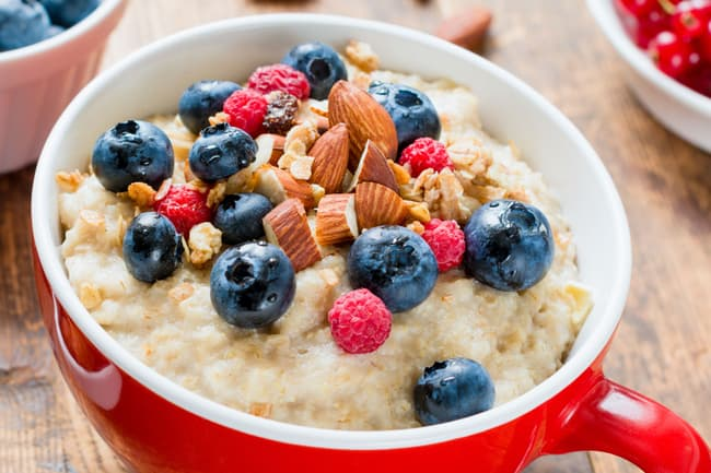 photo of oatmeal with berries and nuts