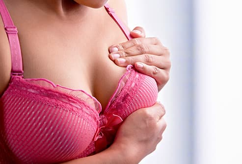 woman doing self breast exam