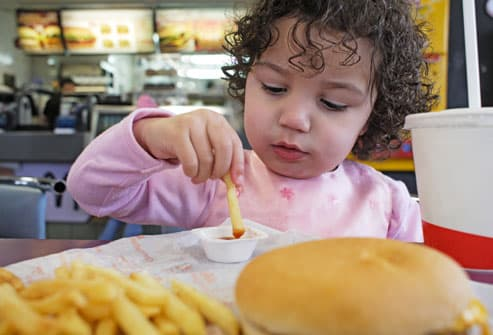 Child Eating Unhealthy Food