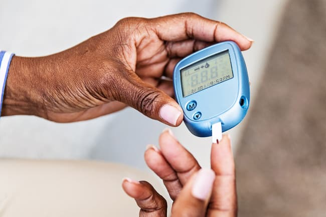 photo of checking blood glucose
